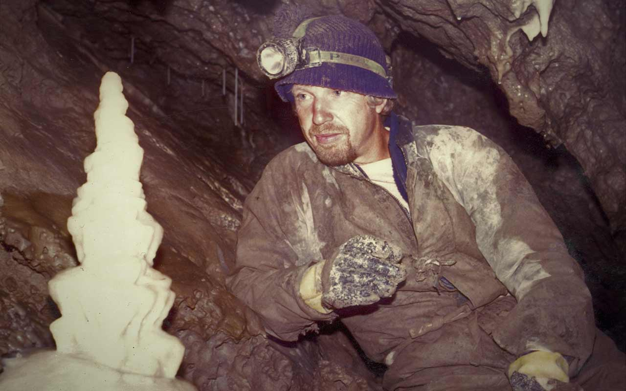 The early days - Chas inspects the Wedding Cake formation in Rat's Nest Cave, AB. Photo by Dave Thomson